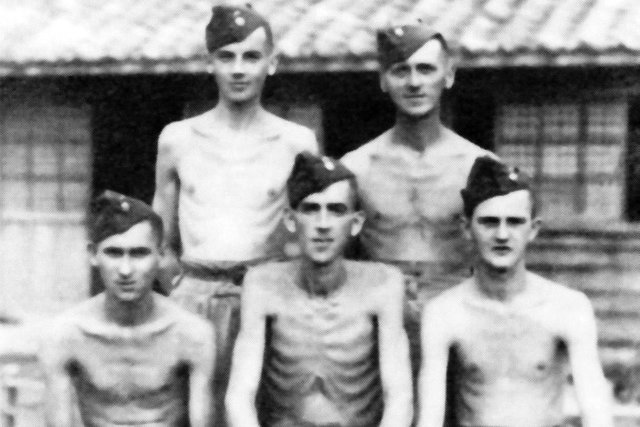Five emaciated British soldiers after being liberated from a Japanese prisoner of war camp.
