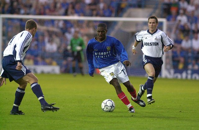 Courtney Pitt, seen here taking on Spurs' Chris Perry in a July 2001 pre-season friendly, made 41 appearances for Pompey. Picture: Steve Reid