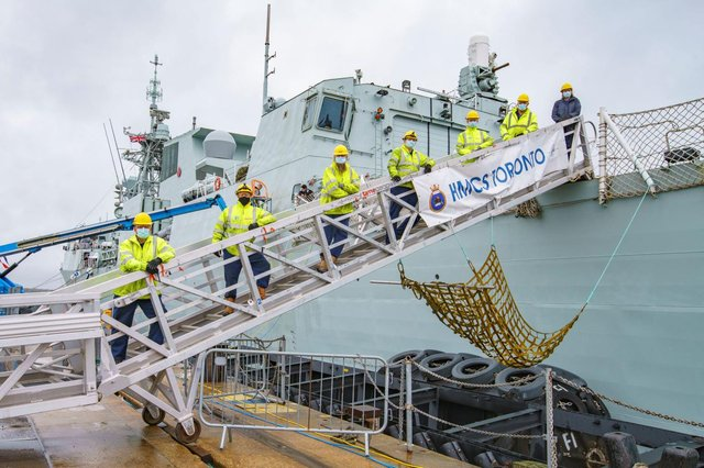 Engineers from BAE Systems pictured on HMCS Toronto, a Canadian warship they helped repair in Portsmouth. Photo: BAE Systems.