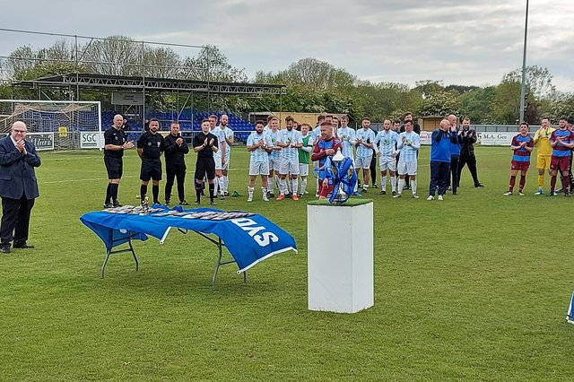 Hamworthy United's Steve Devlin about to collect his man of the match award following the Hammers' 3-1 win over US Portsmouth in the Wessex League Cup final at AFC Portchester this afternoon.