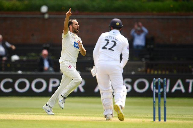 Lewis Gregory of Somerset celebrates after taking the wicket of Ian Holland on the final day of the drawn Championship encounter at Taunton today. Photo by Harry Trump/Getty Images.
