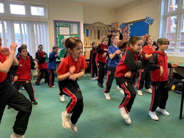 Year 5 pupils take part in marathon dance challenge.