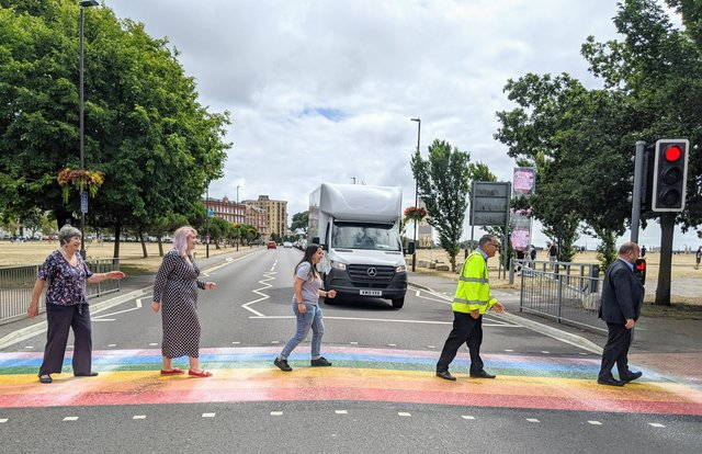 A colourful rainbow crossing has been created on Duisburg Way by Portsmouth City Council to celebrate the city's LGTBQ+ community. Traffic boss Cllr Lynne Stagg, LGBTQ+ champion Cllr Claire Udy, Tally Aslam from Portsmouth Pride, Ray Muscat from Colas and Cllr Steve Pitt
