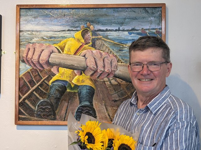 Tom Bennett with his prize-winning painting, The Rhythm of Stroke