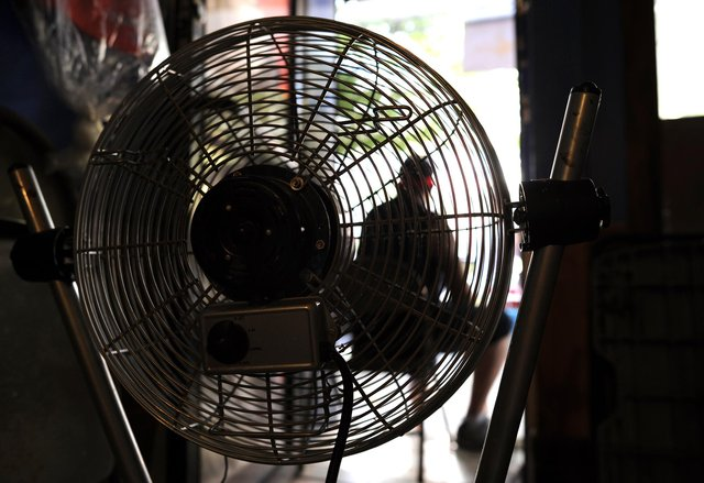 Should you sleep with a fan on? Picture: TIMOTHY A. CLARY/AFP via Getty Images