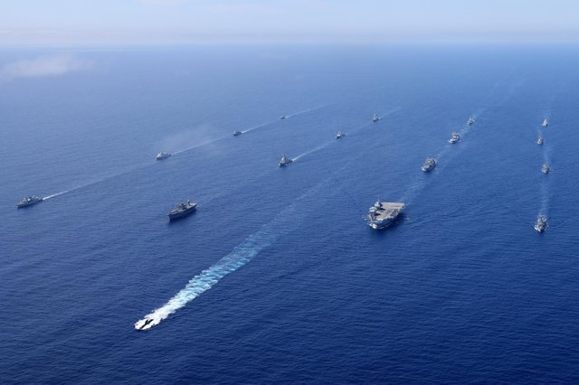 HMS Queen Elizabeth and the UK Carrier Strike Group joined ships from NATO Standing Maritime Groups One and Two for an impressive display of maritime power in the Eastern Atlantic on 28 May 2021. The rendezvous was part of Steadfast Defender 21, a large scale defensive exercise designed to test NATO's ability to rapidly deploy forces from North America to the coast of Portugal and the Black Sea region.