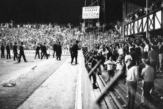 Police dealing with disturbances at Fratton Park in September 1986. The News PP1090