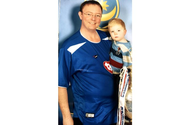 Mark Hancock with his son Matthew in 2003 when he weighed 16 stones.