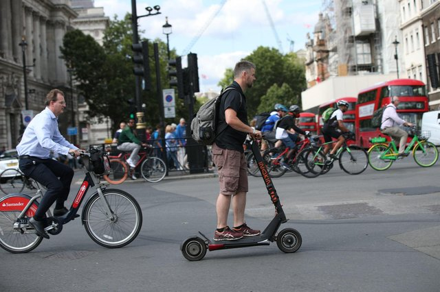 A person riding an electric scooter in Westminster, London. Picture: Yui Mok/PA Wire