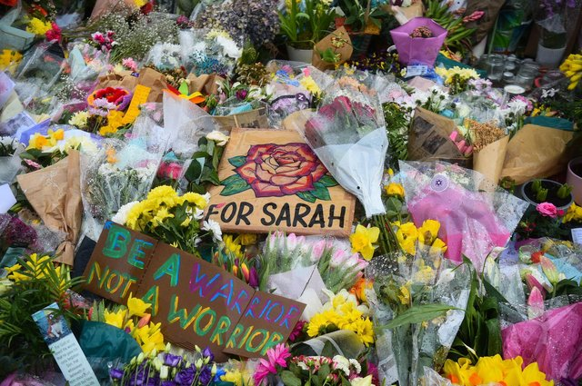 Floral tributes left next to the bandstand in Clapham Common, London, for Sarah Everard. Pc Wayne Couzens, 48, appeared at the Old Bailey in London charged with the kidnap and murder of the 33-year-old. Picture date: Tuesday March 16, 2021. Picture: Kirsty O'Connor/PA Wire