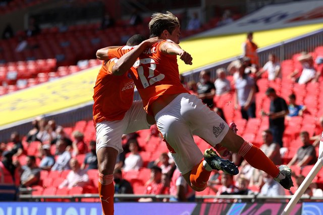 LONDON, ENGLAND - MAY 30: Kenny Dougall of Blackpool celebrates with Keshi Anderson after scoring their side's first goal during the Sky Bet League One Play-off Final match between Blackpool and Lincoln City at Wembley Stadium on May 30, 2021 in London, England. (Photo by Catherine Ivill/Getty Images)