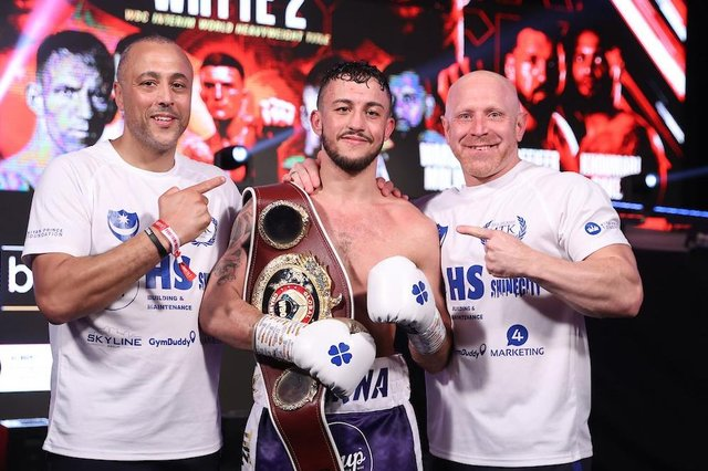 Mikey McKinson, centre, with his WBO Global title with father and trainer Michael Ballingall, left, and Gavin Jones. Picture: Mark Robinson/Matchroom Boxing