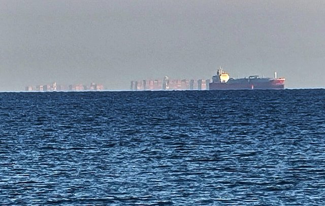 Caption: A mirage of an 'Eastern bloc' city hovering above the Solent has been spotted from Eastney