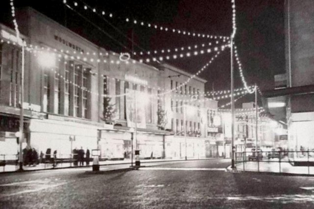 Commercial Road after the shops closed. Woolworth's, Littlewoods and John Collier can be seen. Picture: The News archive
