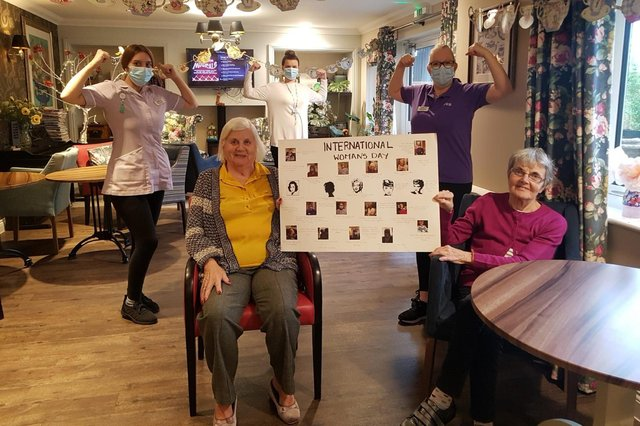 Margaret Horsted and Sue Cobb, residents at Care UK's Pear Tree Court, as well as team members Chloe Turner, Emily Forbes and Jacqui Dye celebrate International Women's Day