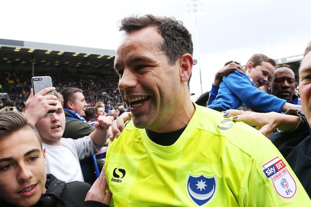 David Forde celebrates Pompey's League Two promotion at Notts County. Picture: Joe Pepler