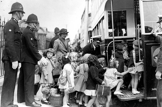 Portsmouth children being evacuated in 1939. The girl on the left is Marjorie Charman nee Watts. Evacuees board buses at George Street, Portsmouth at the beginning of the Second World War. The News PP5415