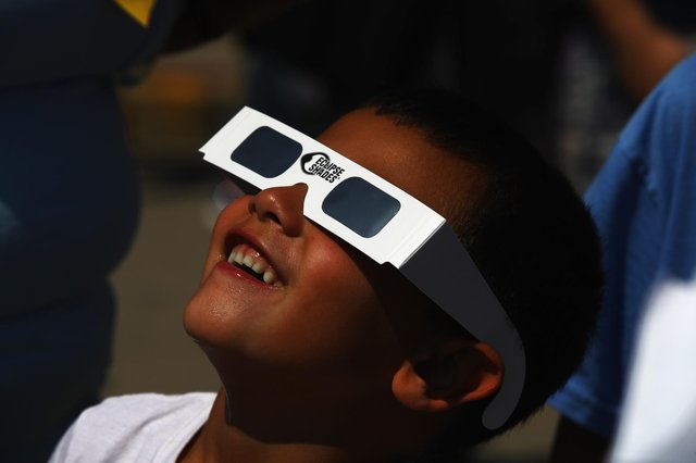 Partial solar eclipse is taking place this morning. (Photo by Bruce Bennett/Getty Images)