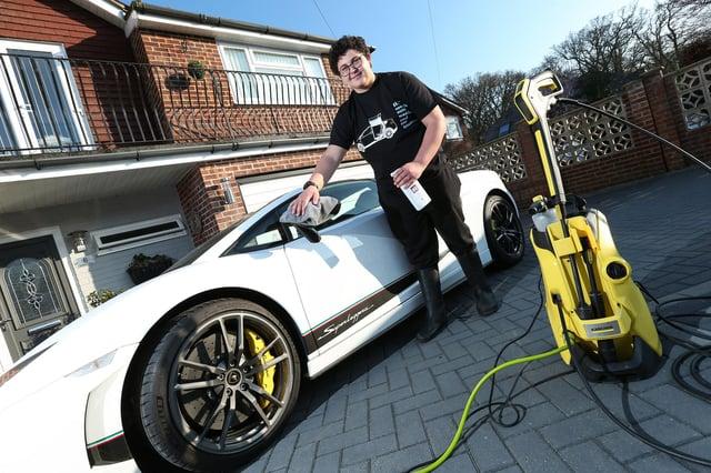 Hugh Clark, 14, has started a car washing business. His aim is to buy his dream car like this Lamborghini Superleggera. Picture: Chris Moorhouse (230321-26)
