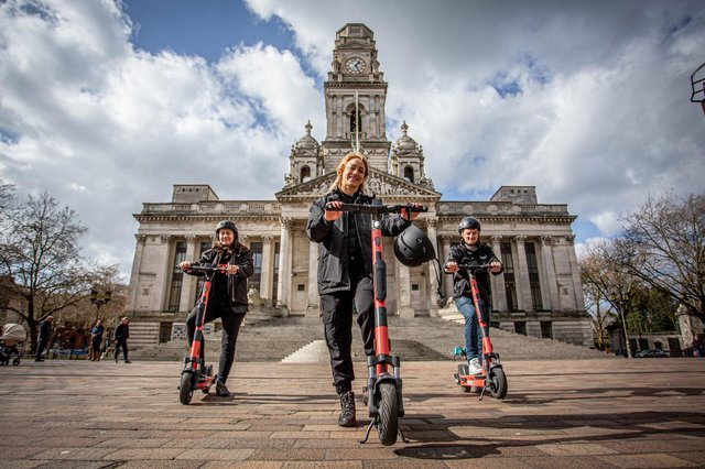 The e-scooter rental trial launched in Portsmouth last week.  Pictured: Voi scooter team, Jon Hamer, Maria Sassetti and Nikolina Kotur on the e-scooters at Portsmouth Guildhall walk on 15 March 2021. Picture: Habibur Rahman