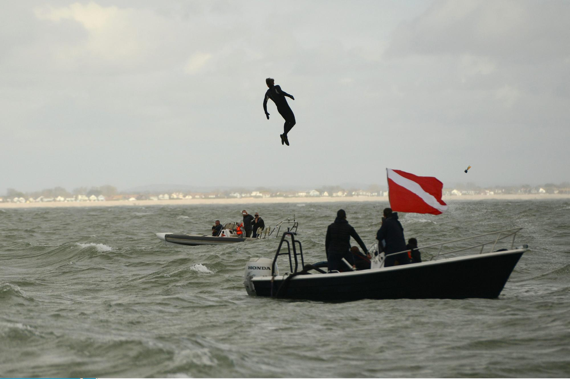 Hayling Island former paratrooper left with bruised bottom after leaping 140ft into the sea