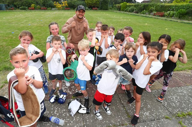 Mikey McKinson, furthest back, with some Heart of Hayling Boxing Academy youngsters. Picture: Stuart Martin (220421-7042)