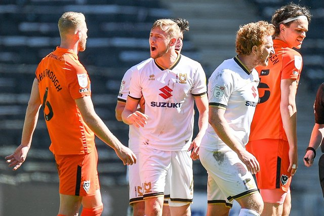 MK Dons substitute Charlie Brown confronts Jack Whatmough following the challenge which saw the Pompey defender sent off.