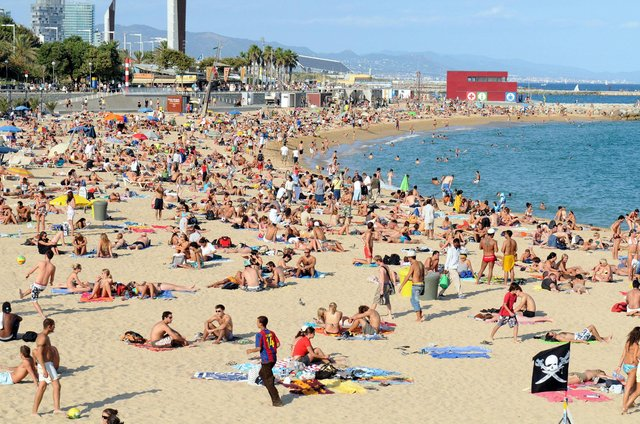 File photo dated 08/09/08 of a general view of Platja Nova Icarie beach in Barcelona. Photo: Owen Humphreys/PA Wire