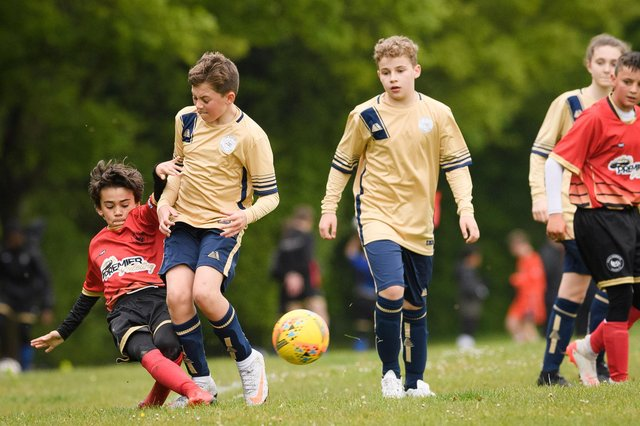Action from Paulsgrove Black under-13s (red) Mid Solent Youth League under-13 C Division meeting with Lee Rangers White. Picture: Keith Woodland (080521-414)