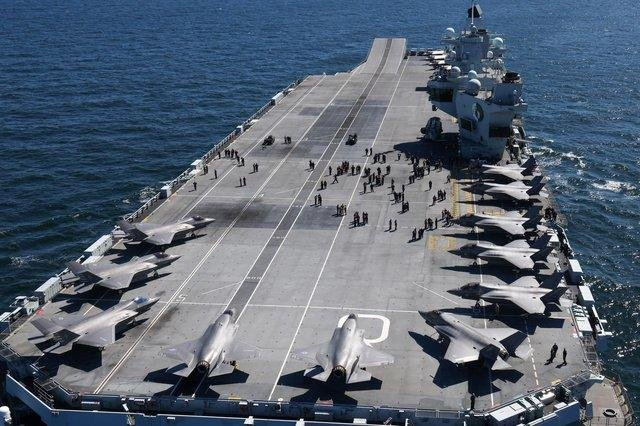 HMS Queen Elizabeth pictured with her embarked squadron of British and American F-35 jets.Photo: Royal Navy.