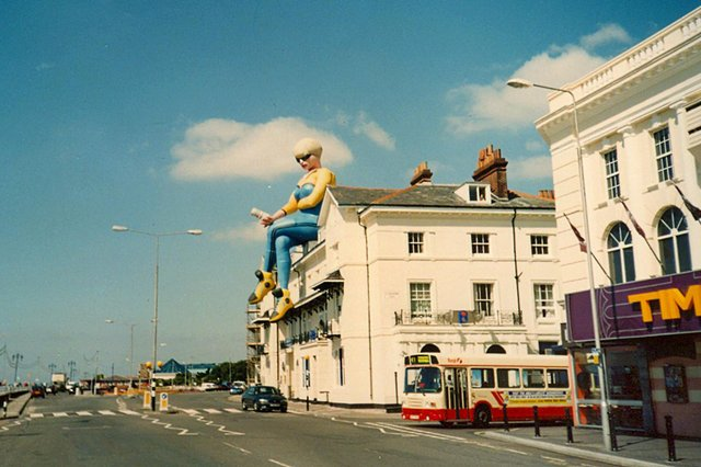 A giant balloon in the shape of a woman sitting on the roof above Bar Bluu in South Parade, Southsea, 1999. Picture: Doreen Gallacher.