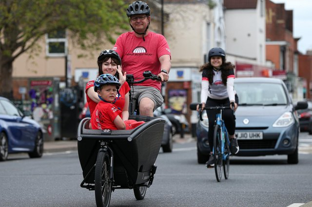 Kevin Watkins pedals his son Max, seven, and Emma Strong in his cargo bike Picture: Chris Moorhouse (jpns 060621-37)