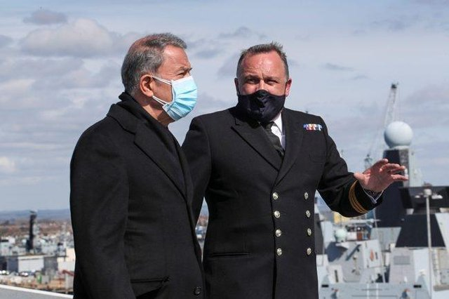 Image of Commander Air, Philip Beacham (right), leads a tour of the flight deck with His Excellency Hulusi Akar (left).
