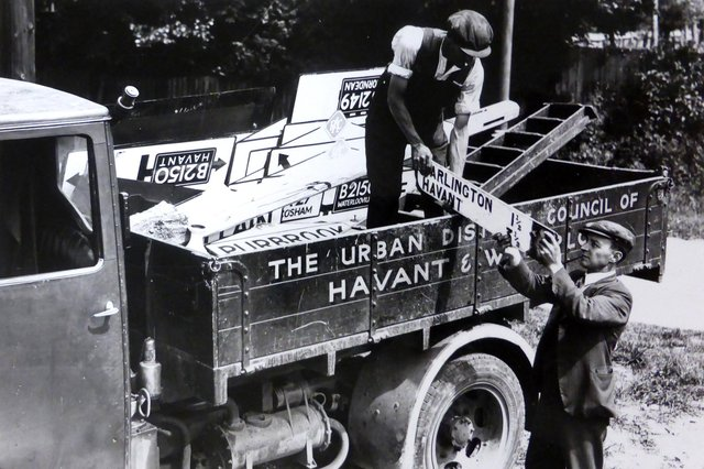 Road signs being removed in Cosham so any German invaders would not know where they were. Picture: Mike Beel collection