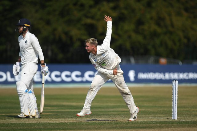 Felix Organ on his way to capturing four wickets on day three at Radlett. Photo by Alex Davidson/Getty Images.