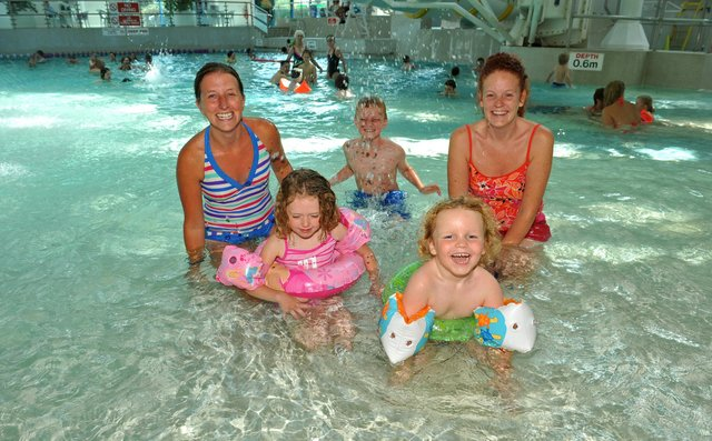 August 2010. Kate Fraiser (back right with her sons Liam (8,back) and Jude (4, front right) with Carly Allen (left) and her daughter Lily (4,front right) enjoying themselves at The Pyramids in Southsea which re-opened under new management. Picture: Steve Reid 102444-43