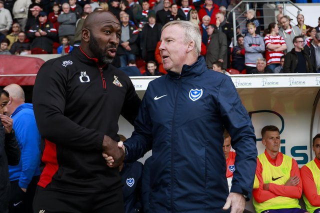 Darren Moore and Pompey boss Kenny Jackett before last season's Keepmoat Stadium encounter which the Blues won 2-1. Picture: Daniel Chesterton/PinPep