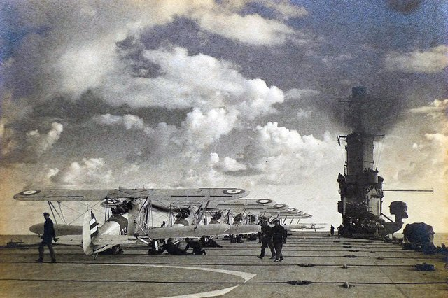 Swordfish aircraft are lined up on Ark Royal's flight deck during her spring cruise in 1939. Note the arrestor cables which pilots had to use great skill to hook on to come to a halt when landing.Picture: Courtesy of Tim King