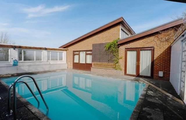 The house comes with a sunken swimming pool.