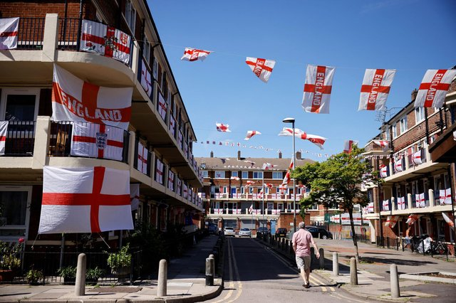 St George's flags, the national flag of England, fly from residents' homes at the Kirby Estate in Bermondsey - which Portsmouth residents have traveled up to visit, apparently. Picture: TOLGA AKMEN/AFP via Getty Images