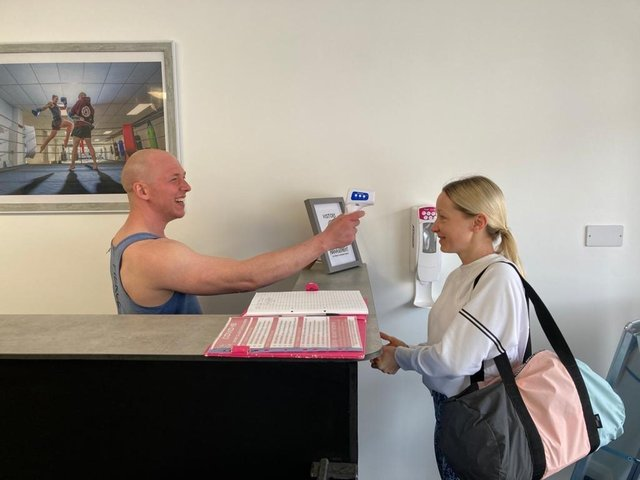 Paul Massey takes the temperature of member Hayley Jennings, from Fareham, as she enters his martial arts studio Fierce Muay Thai in West Street, Fareham. Picture: Kimberley Barber