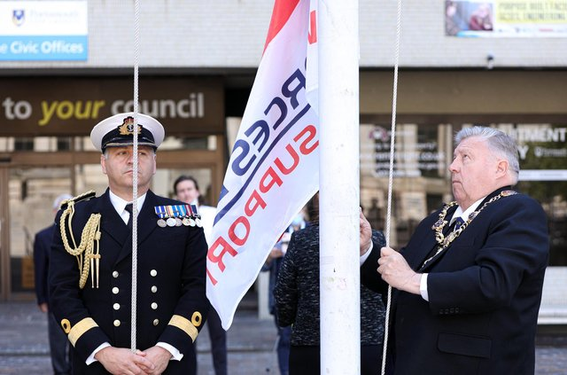 Commander of HM Naval Base, Portsmouth, Cdre Jeremy Bailey, left, looks on as Lord Mayor of Portsmouth, Cllr Frank Jonas raises the Armed Forces Day flag. Raising of the Armed Forces Day flag and the Union flag on Armed Forces Day, Civic Offices, Guildhall Square, PortsmouthPicture: Chris Moorhouse (jpns 250621-06)