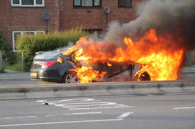 The car on fire. Picture: Bob Hind
