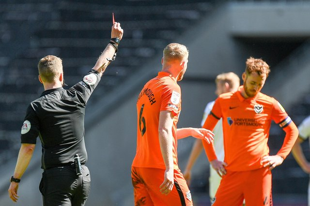 Jack Whatmough picked up a red card for his 80th-minute challenge on MK Dons substitute Charlie Brown.