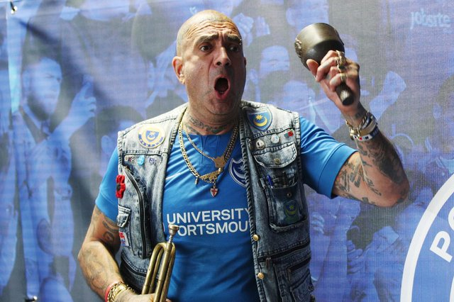 Portsmouth fan John Westwood shows his support outside the ground during the match. Picture: Joe Pepler