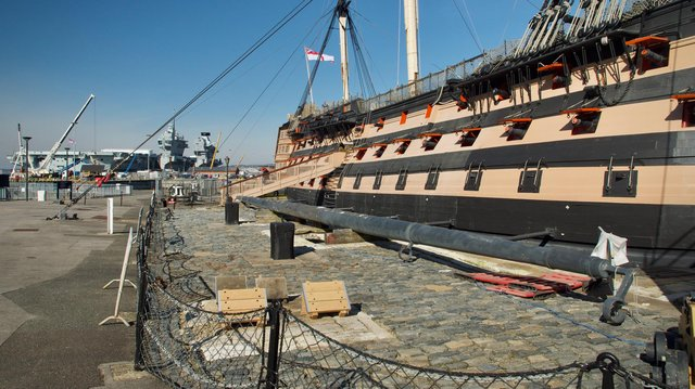 HMS Victory pictured at the dockyard with aircraft carrier HMS Prince of Wales in the background. Photo: Julian Civiero