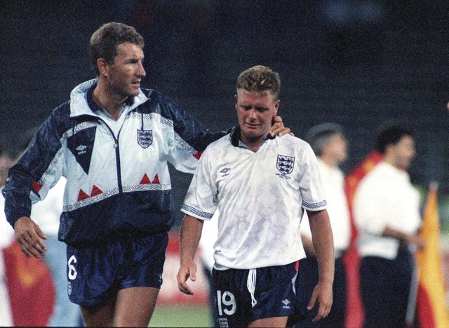 A generation mentally scarred by losing to Germany on penalties - Paul Gascoigne is consoled by Terry Butcher after England's semi-final loss at Italia 90. Picture: Roberto Pfeil, AP