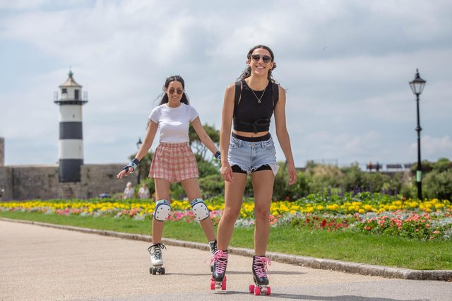 Sisters Josie and Jenny Lake skating outside D-Day story, Southsea. Picture: Habibur Rahman