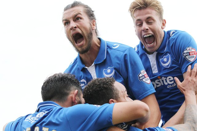 Brian Howard insists his client Christian Burgess is revelling in life in Belgium following last summer's Fratton Park exit. Picture: Joe Pepler