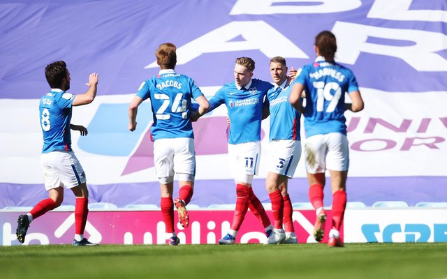 Ronan Curtis celebrates with his Pompey team-mates after scoring in the 2-1 victory over Rochdale. Picture: Joe Pepler